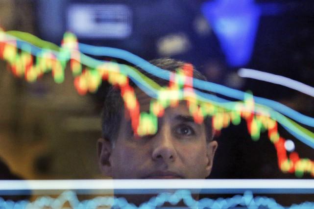 La Bourse de New York a fléchi mardi, les investisseurs faisant preuve de... (Photo AP)