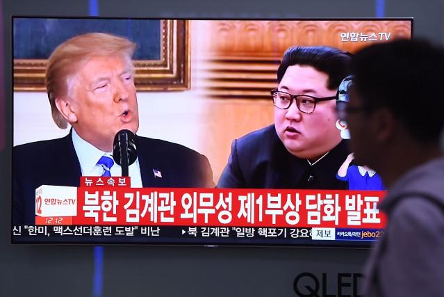 MM. Trump et Kim doivent se rencontrer à... (AFP)