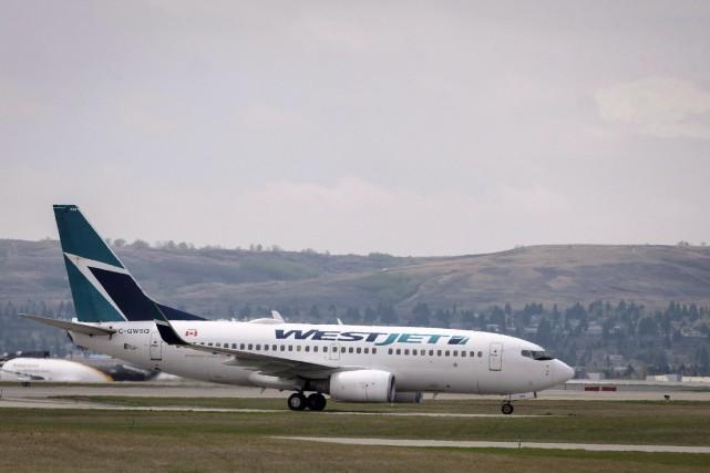 Les pilotes avaient le droit de déclencher une... (PHOTO Jeff McIntosh, LA PRESSE CANADIENNE)