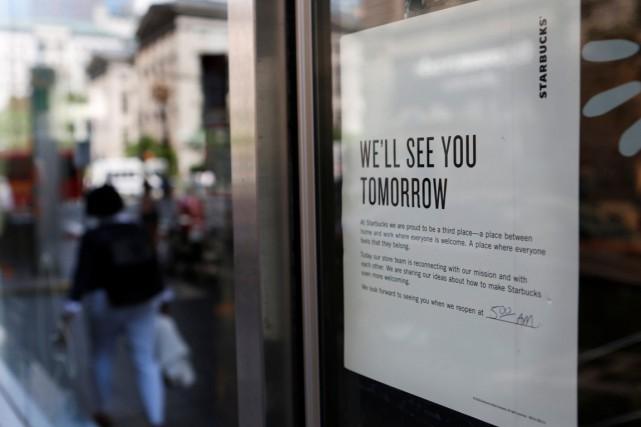 Plus tôt cette semaine, Starbucks a fermé ses... (PHOTO JOE PENNEY, REUTERS)