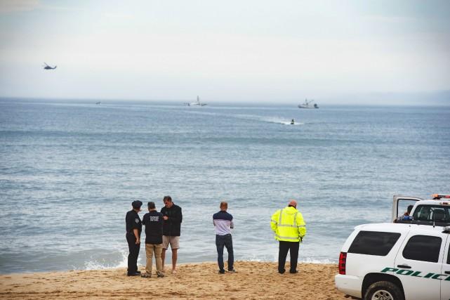 Les garde-côtes ont précisé que leurs équipes ainsi... (Photo Gordon M. Grant, Newsday via AP)