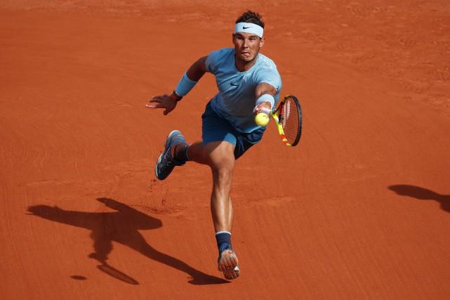 Le numéro 1 mondial Rafael Nadal a défait... (Photo Christophe Ena, AP)