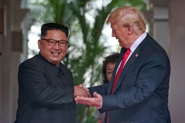 Kim Jong-un et Donald Trump lors de la... (PHOTO ARCHIVES REUTERS)