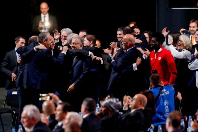 La délégation Canada-États-Unis-Mexique se réjouit du choix des... (PHOTO Pavel Golovkin, AP)