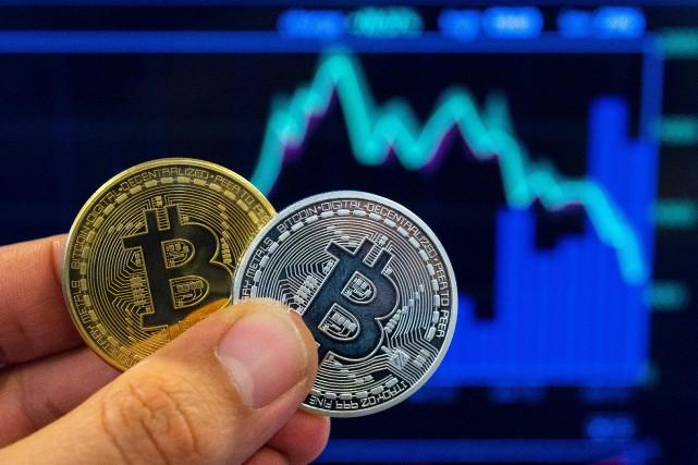 Le bitcoin a atteint une valeur de 19... (AFP)