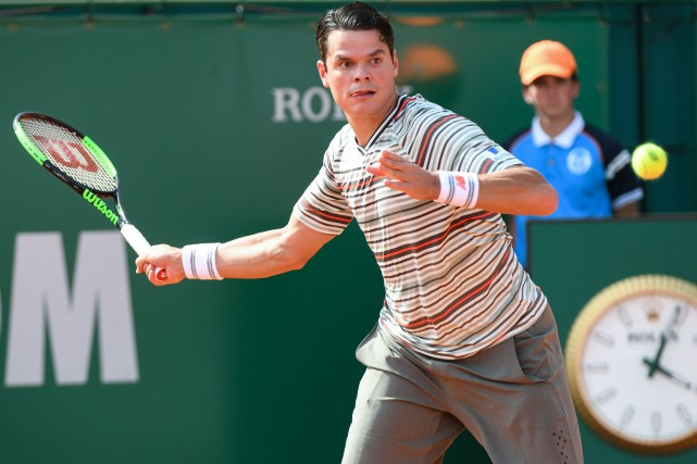 Milos Raonic... (Photo Yann Coatsaliou, archives AFP)