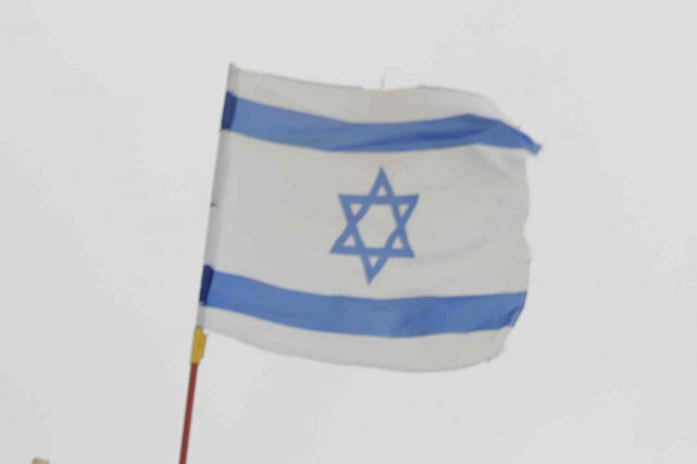 Le drapeau israélien.... (Photo Menahem KAHANA, Agence France-Presse)