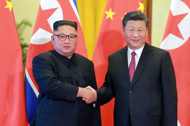 Kim Jong-un etXi Jinping... (AFP)