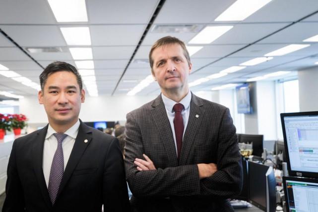 TommyNguyen, directeur des actions canadiennes, et LucGibelleau, gestionnaire... (Photo MarcoCampanozzi, Archives La Presse)