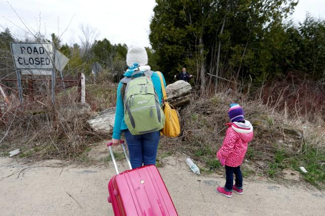 Ces passages de migrants à la frontière américaine... (PHOTO Christinne Muschi, ARCHIVES REUTERS)