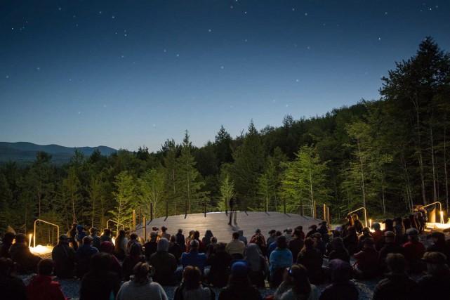 Les spectateurs prennent place dans un amphithéâtre de... (THE CANADIAN PRESS)