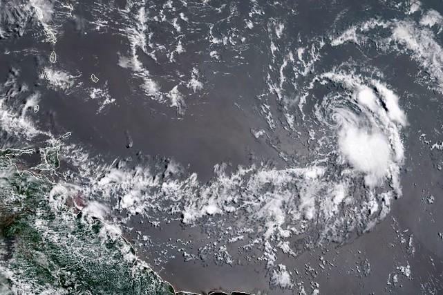 Beryl est redevenue samedi une tempête tropicale, mais on prévoit... (PHOTO SATELLITE AFP/Agence américaine d'observation océanique et atmosphérique)