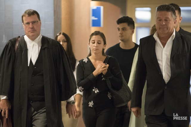Marie-Michèle Benjamin (au centre) a plaidé coupable il y... (Photo Ivanoh Demers, La Presse)