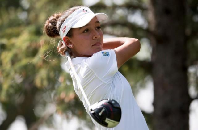 Céleste Dao s'est initiée au golf à l'âge... (PhotoJonathan Hayward, La Presse canadienne)