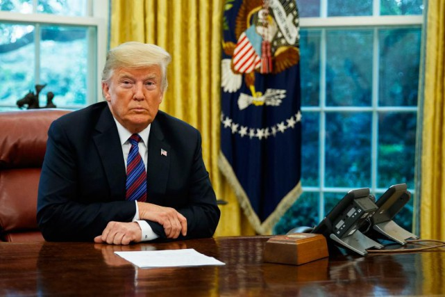 Donald Trump hier lors de son appel conférence... (PHOTO EVAN VUCCI, ASSOCIATED PRESS)
