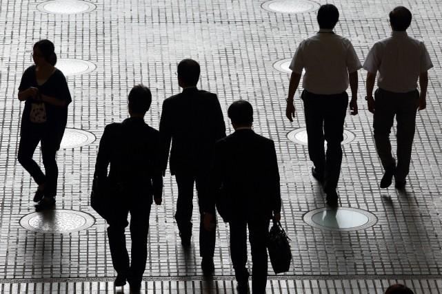 Même si 83% des répondants jugent que travailler... (Photo archives Bloomberg)