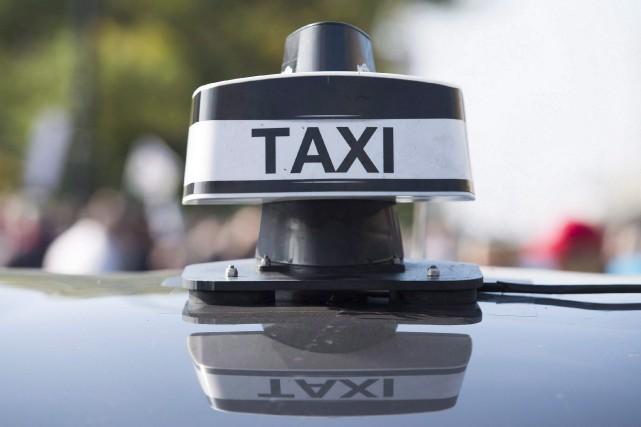 «Nos permis de taxi, tout est à l'eau,... (Photo Graham Hugues, La Presse canadienne)