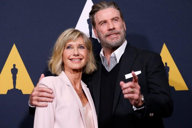 Olivia Newton-John et John Travolta lors des célébrations... (PHOTO ARCHIVES REUTERS)