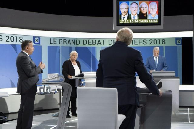 François Legault (à gauche), de la Coalition avenir... (photo Paul Chiasson, PC)