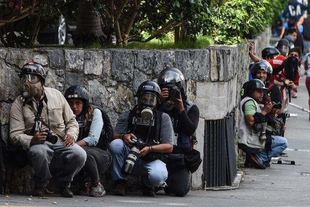 Plusieurs journalistes ont été arrêtés ou expulsés ces... (PHOTO JUAN BARRETO, archives AFP)