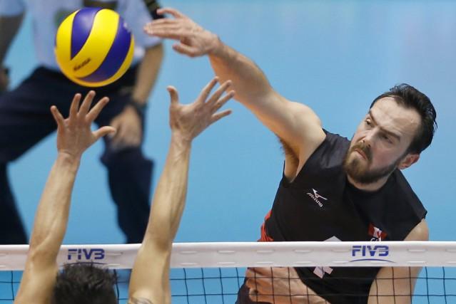 Le volleyeur québécois Nicholas Hoag... (Photo Shizuo Kambayashi, AP)