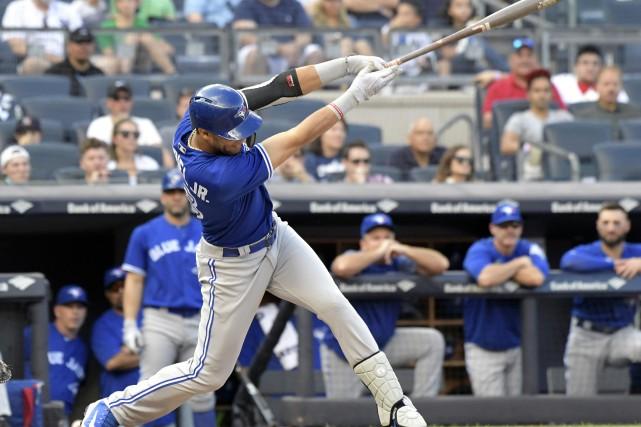 Les Blue Jays ont résisté à une tentative... (Photo Bill Kostroun, Associated Press)