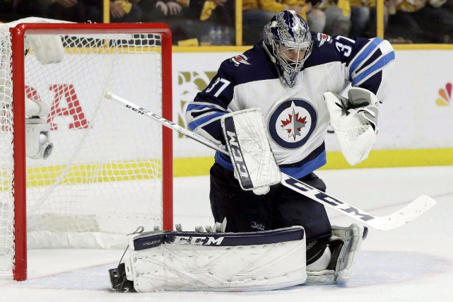 Connor Hellebuyck... (ARCHIVES AP)