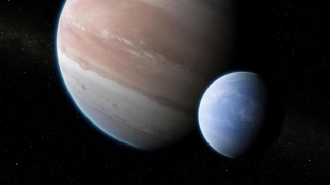 Kepler-1625b et sa lune... (ILLUSTRATION DAN DURDA, FOURNIE PAR SCIENCE ADVANCES)