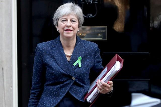 Theresa May... (Photo Simon Dawson, REUTERS)