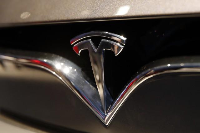 Tesla doit publier ses résultats mercredi après la... (Photo Christophe Ena, AP)