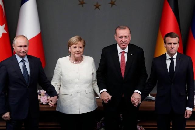 Le président russe, Vladimir Poutine, la chancelière allemande,... (Photo MAXIM SHIPENKOV, AFP)