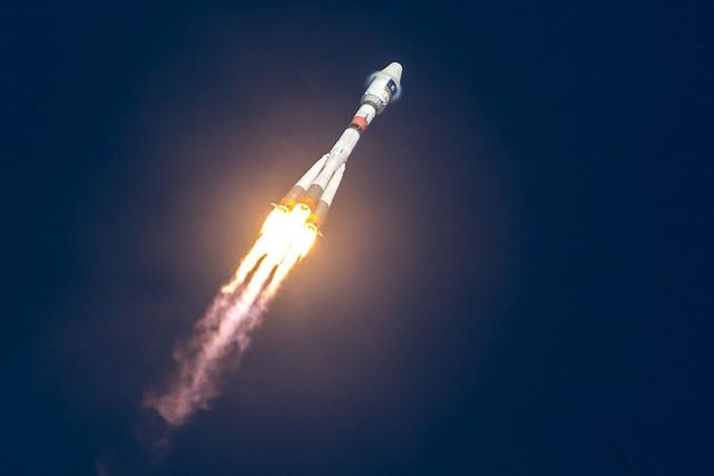 Une fusée Soyouz... (Photo JODY AMIET, archives AFP)
