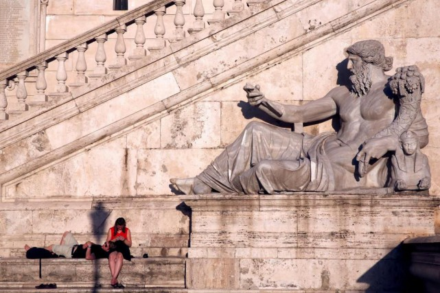 Rome a les voyageurs-et en particulier les fêtards-dans... (PhotoStefano Rellandini, archives Reuters)