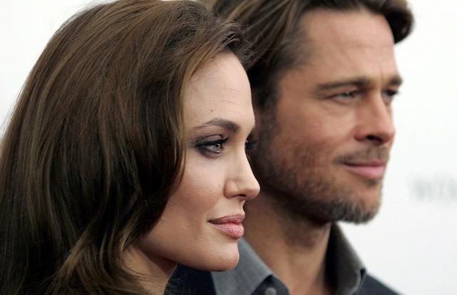 Angelina Jolie et Brad Pitt... (Photo CARLO ALLEGRI, archives REUTERS)