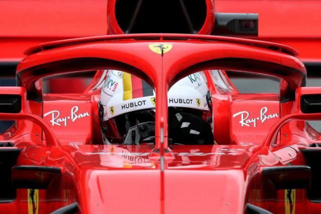 Sébastian Vettel au volant de sa Ferrari... (photo albert gea, archives reuters)
