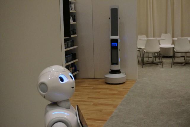 Dans un magasin, le robot Pepper peut reconnaître... (Photo ROBERT LEVER, AFP)