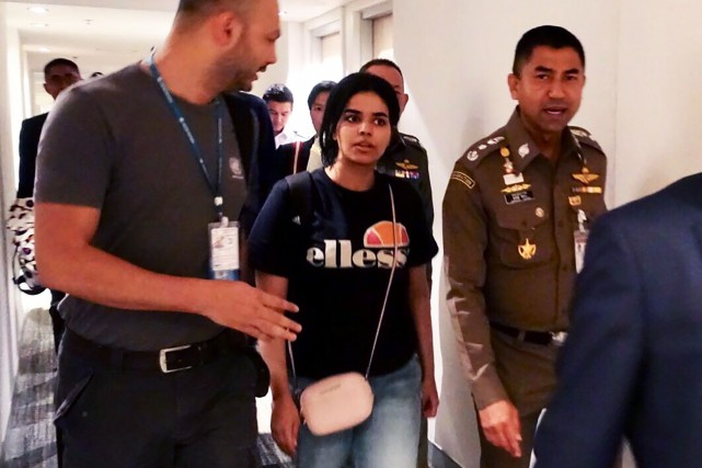 Rahaf Mohammed al-Qanun (au centre).... (Photo archives AFP)