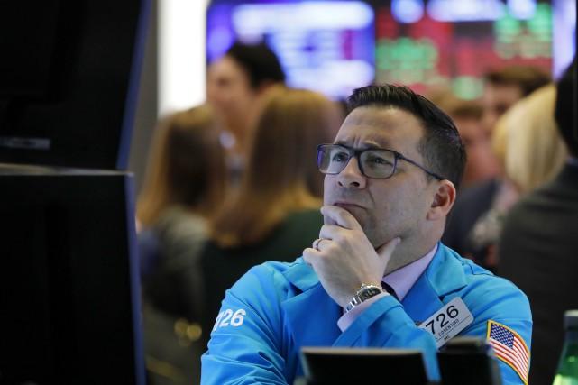 Le Dow Jones perdait 0,49% et le NASDAQ... (Photo Richard Drew, AP)