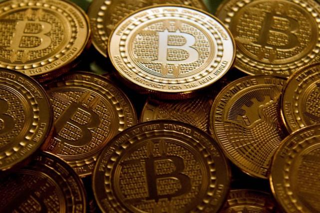 L'univers des cryptomonnaies «échappe pratiquement à toute réglementation... (PHOTO AFP)
