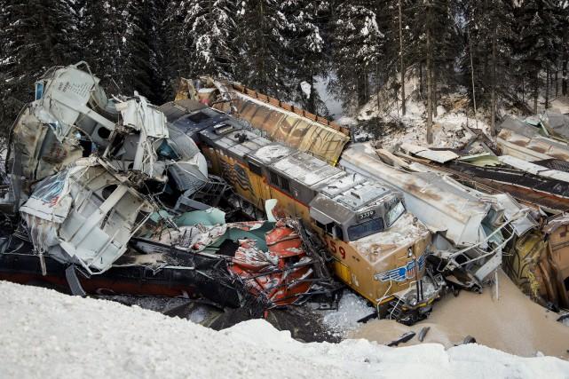 Le déraillement a coûté la vie à trois... (Photo Jeff McIntosh, LA PRESSE CANADIENNE)