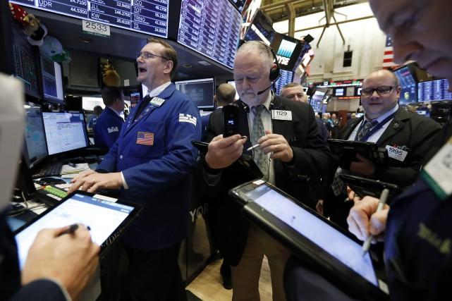 Le Dow Jones a avancé de 0,46% pour... (Photo Richard Drew, Associated Press)