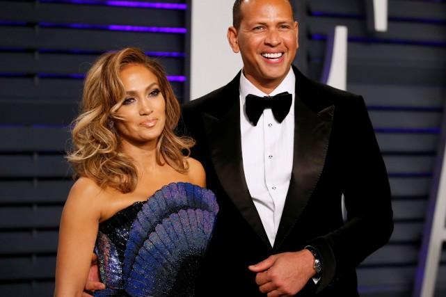 La chanteuse Jennifer Lopez et l'ex-star du baseball américain Alex Rodriguez,... (PHOTO DANNY MOLOSHOK, REUTERS)