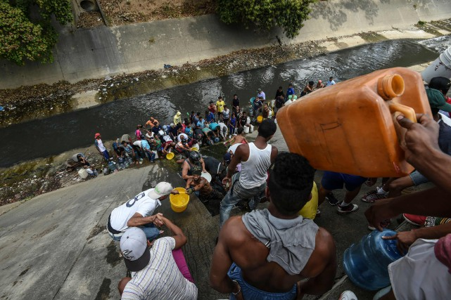 Dans ce quartier populaire de San Agustin, à... (PHOTO JUAN BARRETO, AFP)
