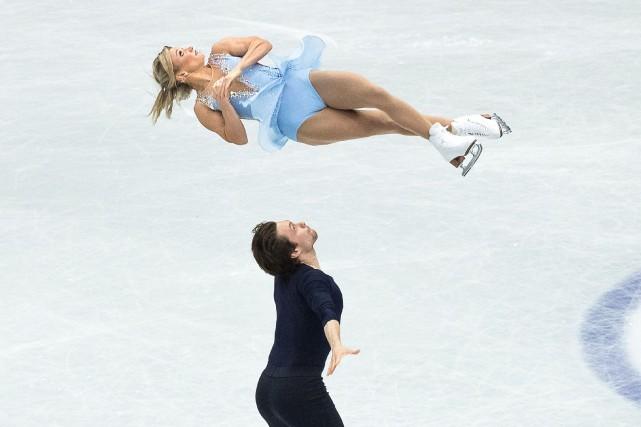 Les Canadiens Kirsten Moore-Towers et Michael Marinaro... (PHOTO NICOLAS DATICHE, AGENCE FRANCE-PRESSE)