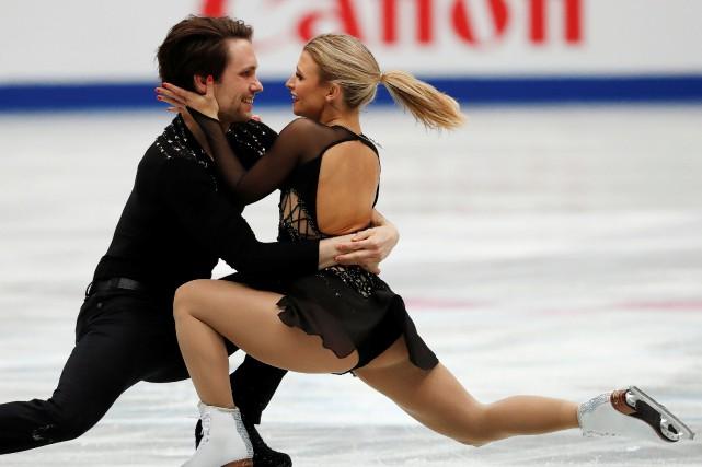 Les patineurs canadiens Michael Marinaro et Kirsten Moore-Towers... (PHOTO ISSEI KATO, REUTERS)