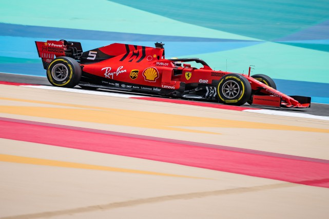 Sebastian Vettel au volant de sa Ferrari au... (PHOTO ANDREJ ISAKOVIC, AFP)