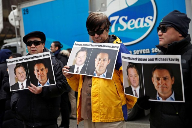 Des manifestants réclament la libération des Canadiens Michael Kovrig... (PHOTO LINDSEY WASSON, ARCHIVES REUTERS)
