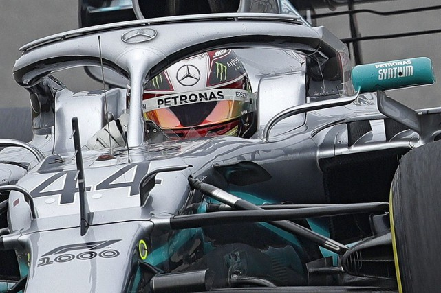 Lewis Hamilton a remporté dimanche le Grand Prix de... (PHOTO ANDY WONG, ASSOCIATED PRESS)