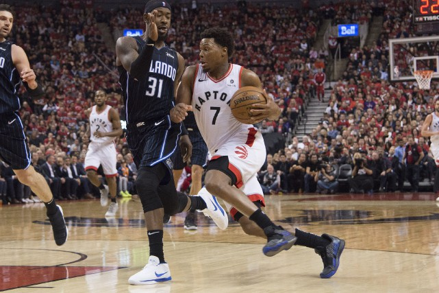 Le joueur des Raptors Kyle Lowry (7) dribble... (PHOTO NICK TURCHIARO, USA TODAY SPORTS)