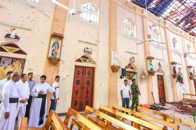 Les six attentats perpétrés contre trois églises et... (PHOTO AFP)